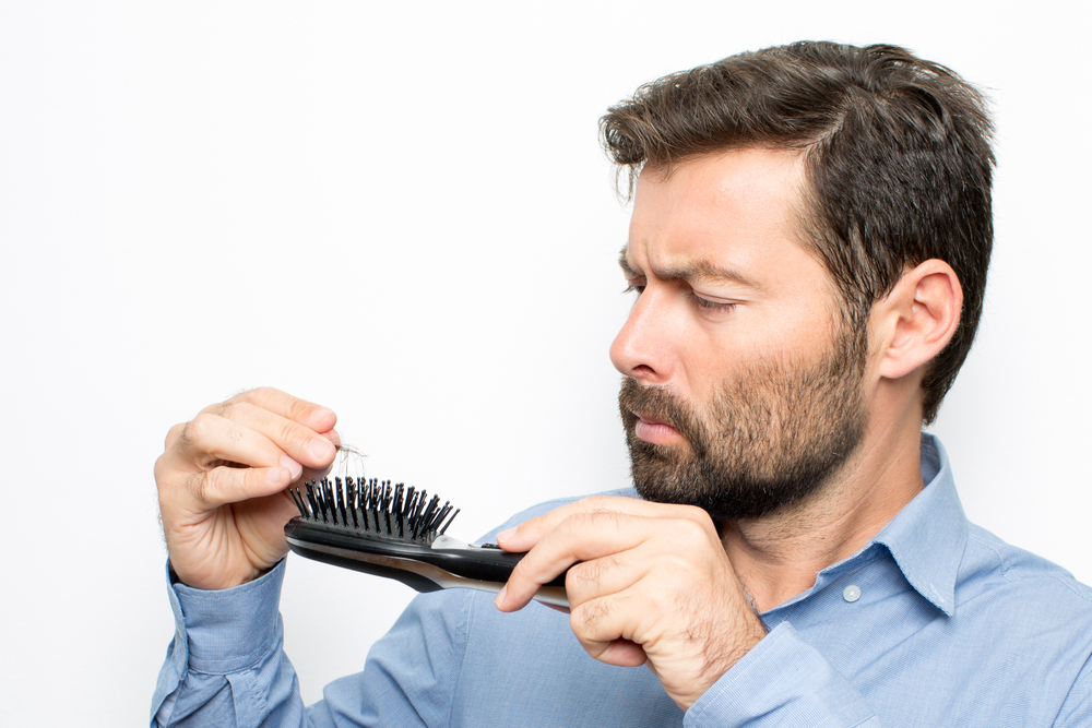 picking hair off comb